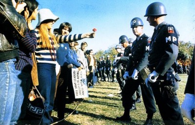 The Etymology of Hippie - Women Offering Flower to Military Police